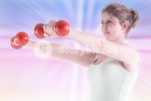 Composite image of woman holding weights