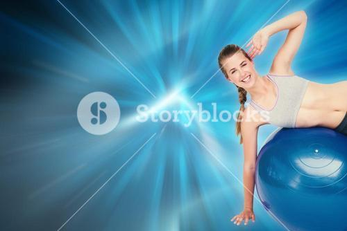 Composite image of portrait of a fit woman stretching on fitness ball