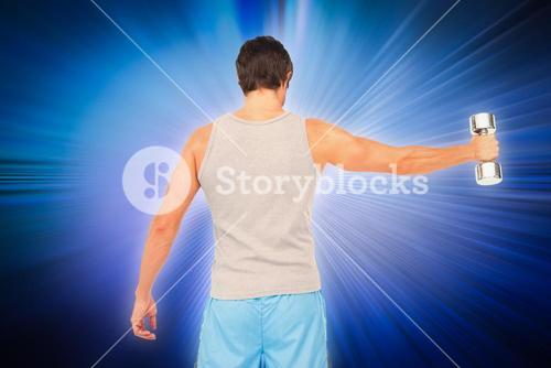 Composite image of rear view of a young man holding out dumbbell