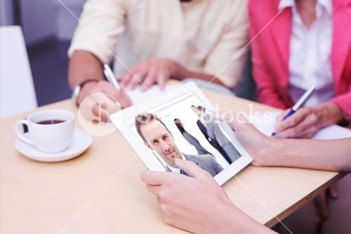 Composite image of creative team using tablet pc