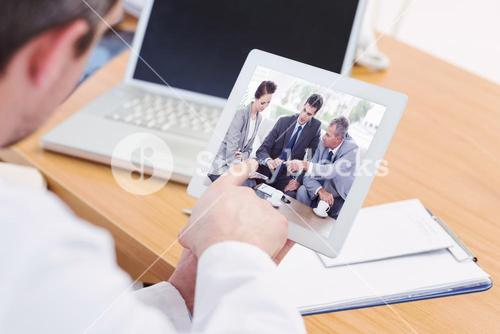 Composite image of work team having a meeting together