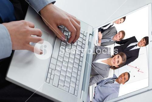 Composite image of happy business group having a meeting