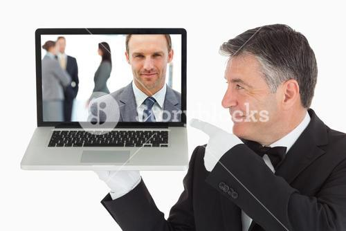 Composite image of proud manager posing in front of his team