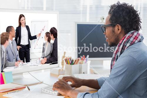 Composite image of assertive businesswoman giving a presentation