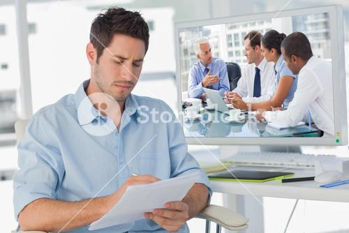 Composite image of group of business people brainstorming together