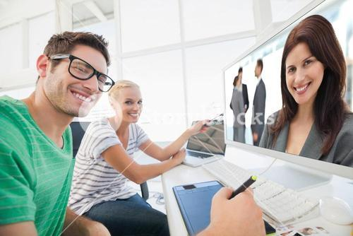Composite image of happy businesswoman posing while her team discussing
