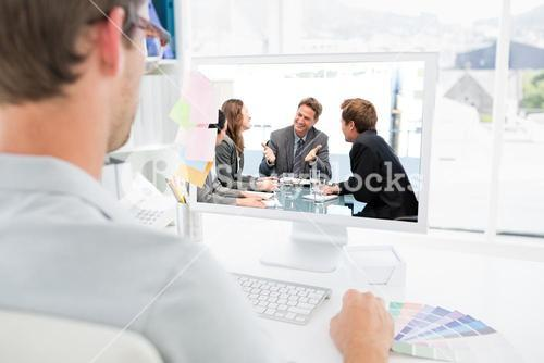 Composite image of happy team laughing together at a meeting