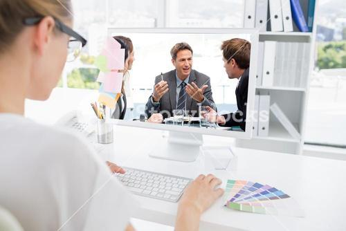 Composite image of charismatic chairman talking with his team