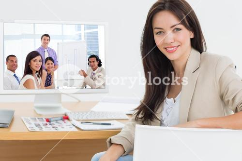 Composite image of young businessman presenting figures