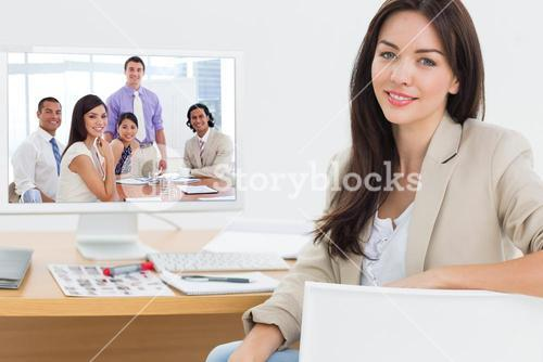 Composite image of international business associates in a meeting