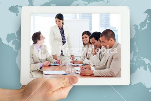 Composite image of charismatic businesswoman doing a presentation