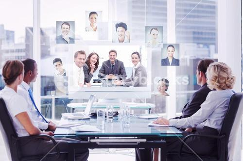 Composite image of group of business people looking at a screen