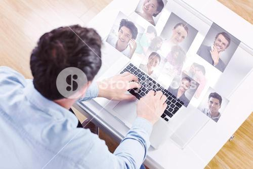 Composite image of creative team going over contact sheets in meeting