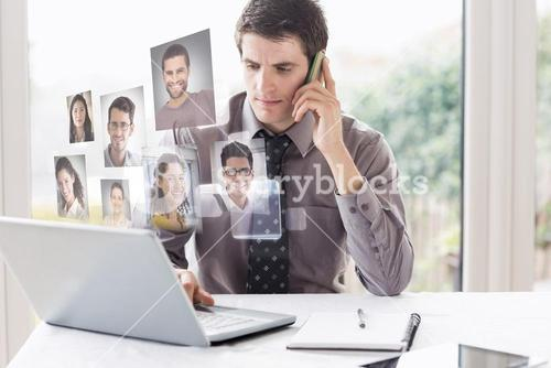 Composite image of business man on phone and laptop