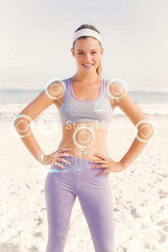 Composite image of sporty blonde on the beach smiling at camera