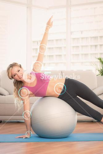 Composite image of happy fit blonde doing side plank with exercise ball