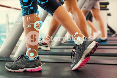 Composite image of row of people working out on treadmills