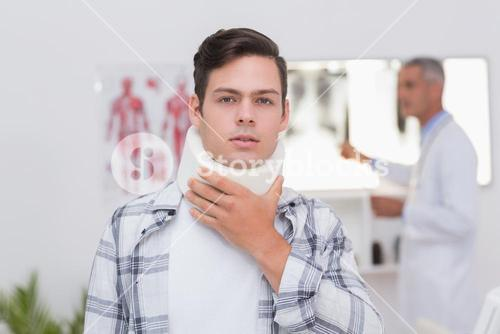 Patient with neck brace looking at camera
