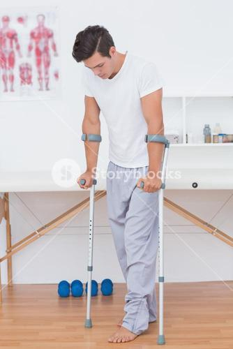 Patient walking with crutch