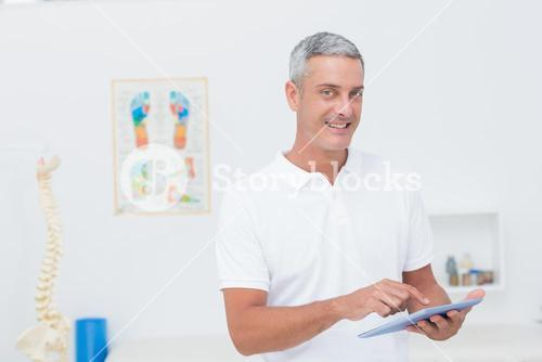 Doctor using tablet pc