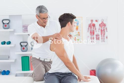 Doctor doing back adjustment