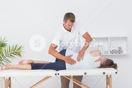 Doctor examining woman back