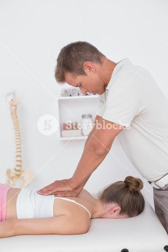 Physiotherapist doing back massage