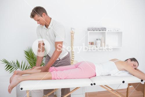 Physiotherapist doing calf massage