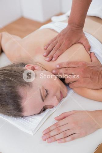 Physiotherapist doing arm massage to his patient