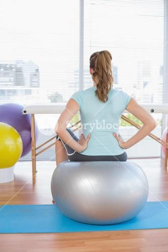 Woman sitting on exercise ball