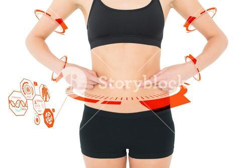 Composite image of closeup mid section of a fit woman with hands on stomach
