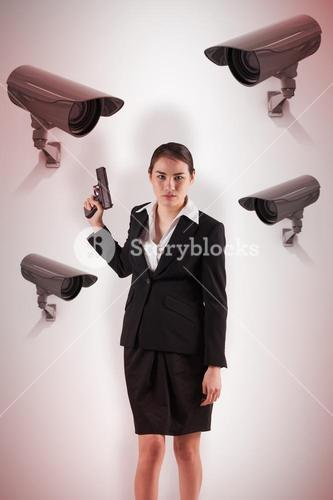 Composite image of businesswoman holding a gun