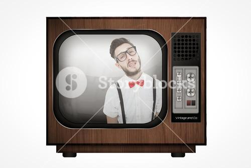 Composite image of geeky young hipster looking at camera