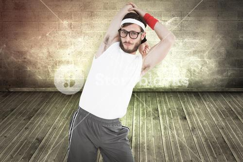 Composite image of geeky hipster stretching in sportswear
