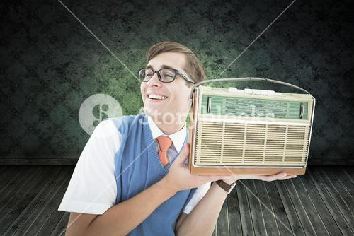 Composite image of geeky hipster listening to retro radio