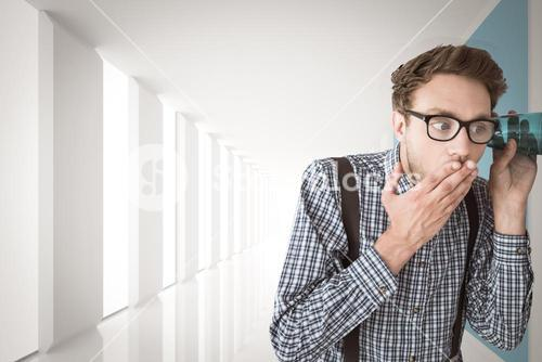 Composite image of geeky businessman eavesdropping with cup