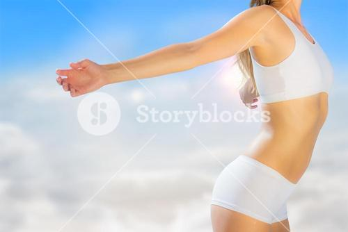 Composite image of gorgeous fit blonde standing with arms out
