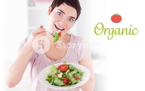 Organic against goodlooking woman eating salad