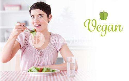Vegan against charming woman eating salad