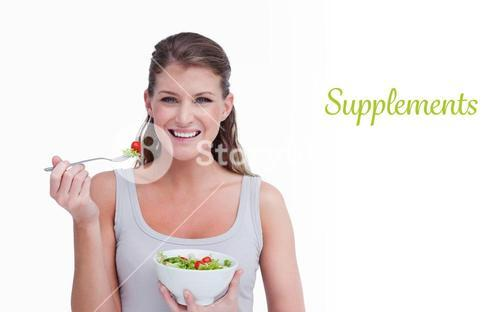 Supplements against woman eating a salad