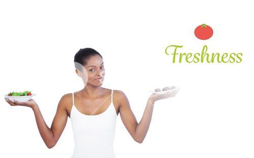 Freshness against pretty woman deciding to eat healthily or not