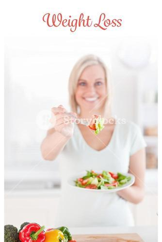 Weight loss against young woman offering salad