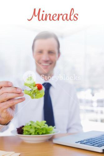 Minerals against businessman eating a salad