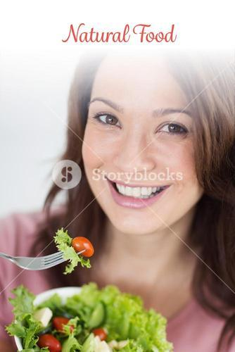 Natural food against closeup of smiling woman with bowl of salad