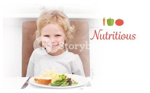 Nutritious against cute little boy eating pasta and salad