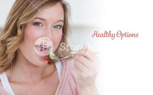 Healthy options against woman eating salad with fork