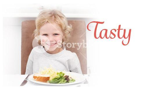 Tasty against cute little boy eating pasta and salad