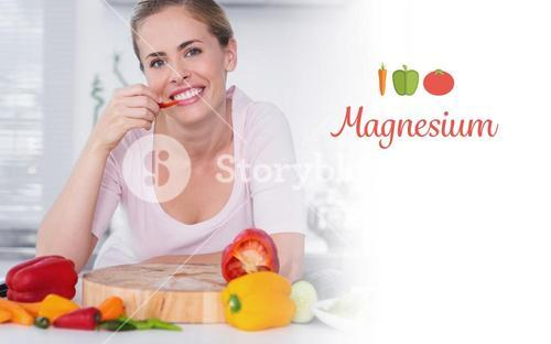 Magnesium against cheerful woman eating vegetables