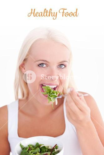 Healthy food against gorgeous woman eating salad