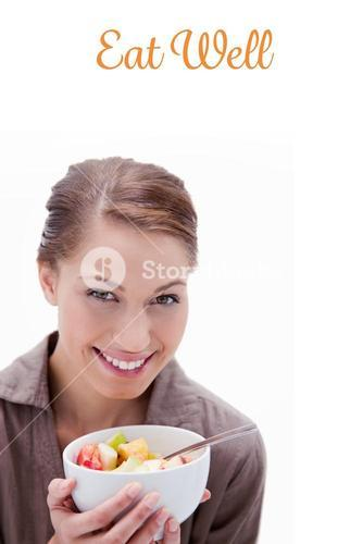 Eat well against smiling woman with bowl of fruit salad